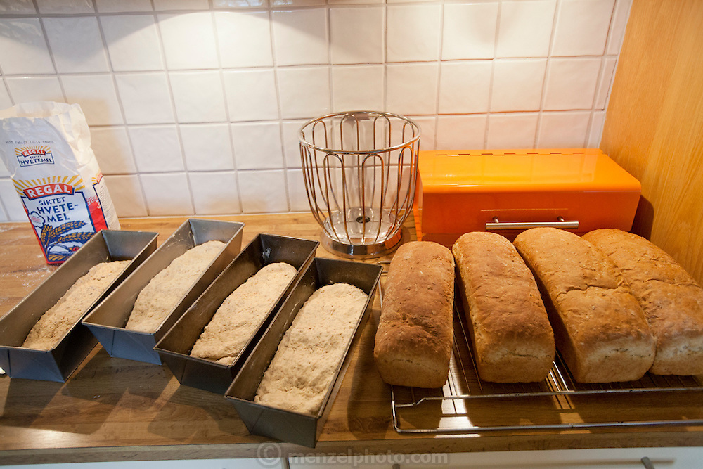 Ottersland Dahl family, of Gjettum, Norway (outside Oslo). Fresh baked bread for family by Gunhild Valle Ottersland, 45. Model-Released.