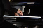 Close up of the pianists hands in a piano concert in the medieval square, 19th July 2015, Lagrasse France.