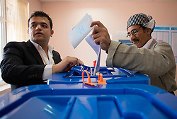 © Licensed to London News Pictures. 30/04/2014. Sulaimaniya, Iraq. An elderly Kurdish man Iraqi places his voting slip into a ballot box during the 2014 Iraqi parliamentary elections in Sulaimaniya, Iraqi-Kurdistan today (30/04/2014). <br /> <br /> The period leading up to the elections, the fourth held since the 2003 coalition forces invasion, has already seen polling stations in central Iraq hit by suicide bombers causing at least 27 deaths. Photo credit: Matt Cetti-Roberts/LNP