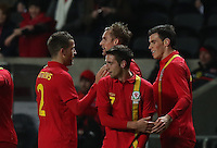 Pictured: Gareth Bale of Wales (R) with team mates  L-R Adam Matthews, Jack Collison and Joe Allen celebrating his opening goal. Wednesday 06 February 2013..Re: Vauxhall International Friendly, Wales v Austria at the Liberty Stadium, Swansea, south Wales.