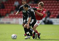 Photo: Paul Thomas.<br /> Walsall v Swansea. Coca Cola League 1.<br /> 27/08/2005.<br /> <br /> Leon Britton and Darren Wrack.