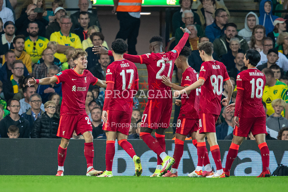 NORWICH, ENGLAND - Tuesday, September 21, 2021: Liverpool's Kostas Tsimikas (L) celebrates wuth goal-scorer Divock Origi (#27) after the second goal during the Football League Cup 3rd Round match between Norwich City FC and Liverpool FC at Carrow Road. Liverpool won 3-0. (Pic by David Rawcliffe/Propaganda)