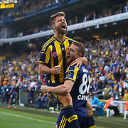 Fenerbahce's Caner Erkin (R) celebrate his goal with  Diego Ribas (L) during their Turkish superleague soccer match Fenerbahce between Balikesirspor at the Sukru Saracaoglu stadium in Istanbul Turkey on Saturday 02 May 2015. Photo by TURKPIX