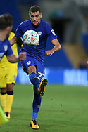 Stuart O'Keefe of Cardiff city © in action. Carabao Cup 2nd round match, Cardiff city v Burton Albion at the Cardiff City Stadium in Cardiff, South Wales on Tuesday 22nd August  2017.<br /> pic by Andrew Orchard, Andrew Orchard sports photography.