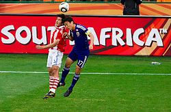 Cristian Riveros of Paraguay vs Makoto Hasebe of Japan during the 2010 FIFA World Cup South Africa Round of Sixteen football match between Paraguay and Japan on June 29, 2010 at Loftus Versfeld Stadium in Tshwane/Pretoria. (Photo by Vid Ponikvar / Sportida)