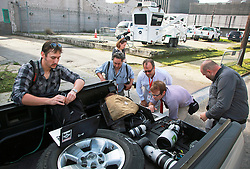 16 March 2015. New Orleans, Louisiana.<br /> Photogrpahers check their images to try and get a positive ID on Robert Durst who was unloaded from a police cruiser in 'the tunnel,' a heavily shadowed area inside the Orleans Parish Criminal District Court. Durst, subject of HBO's 'The Jinx' faced an  extradition hearing. <br /> Photo; Charlie Varley/varleypix.com