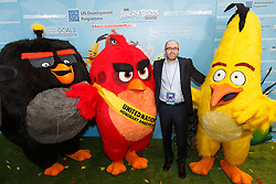 """Producer of the Angry Birds movie John Cohen poses for a photo with """"Chuck"""", """"Red"""" and """"Matilda"""" (L to R) during the """"Angry Birds for a Happy Planet"""" campaign, at the United Nations headquarters in New York, March 18, 2016. UN Secretary-General Ban Ki-moon appointed Red from the Angry Birds as Honorary Ambassador for Green on the International Day of Happiness and encouraged young people to take action on climate change and make the Angry Birds happy. EXPA Pictures © 2016, PhotoCredit: EXPA/ Photoshot/ Li Muzi<br /> <br /> *****ATTENTION - for AUT, SLO, CRO, SRB, BIH, MAZ, SUI only*****"""