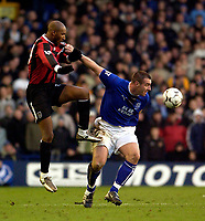 Photo. Jed Wee.<br /> Everton v Manchester City, FA Barclaycard Premiership, Goodison Park, Liverpool. 07/12/03.<br /> Everton's David Unsworth (R) uses his strength to keep Man City's Nicolas Anelka at bay.