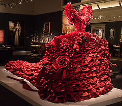"""Sotheby's, London, January 14th 2016. Paper artist ZOE BRADLEY exhibits spectacular paper sculptures inspired by the fashion in old master paintings. Her astonishing works are exhibited alongside 460 royal and aristocratic heirlooms  that will appear in Sotheby's """"Of Royal and Noble Descent"""" auction to be held between 14th and 18th January. PICTURED: A monumental red ruffle gown  made up of 5,940 ruffles of paper. ///FOR LICENCING CONTACT: paul@pauldaveycreative.co.uk TEL:+44 (0) 7966 016 296 or +44 (0) 20 8969 6875. ©2015 Paul R Davey. All rights reserved."""