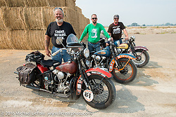 """Left to right - Carl Olsen with his 1936 Harley-Davidson Knucklehead, Scott Wages, the """"Golden Ticket"""" winner who won the opportunity to ride the entire Cannonball on this 1936 Harley-Davidson Knucklehead from Carl's Cycle and Jason Sims on another Carl's Cycle 1939 Harley-Davidson Knucklehead during stage 13 (257 miles) of the Motorcycle Cannonball Cross-Country Endurance Run, which on this day ran from Elko, NV to Meridian, Idaho, USA. Thursday, September 18, 2014.  Photography ©2014 Michael Lichter."""