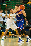 WACO, TX - JANUARY 7: Ishmail Wainright #24 of the Baylor Bears defends against Brannen Greene #14 of the Kansas Jayhawks on January 7, 2015 at the Ferrell Center in Waco, Texas.  (Photo by Cooper Neill/Getty Images) *** Local Caption *** Ishmail Wainright; Brannen Greene
