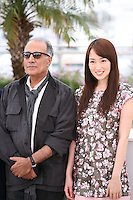Director and scriptwriter Abbas Kiarostami, Actress, Rin Takanashi, at the Like Someone In Love film photocall at the 65th Cannes Film Festival France. Monday 21st May 2012 in Cannes Film Festival, France.