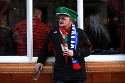 A Wales fan with a drink outside a pub ahead of the Guinness Six Nations match at the Principality Stadium, Cardiff.