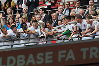Football - 2019 Buildbase FA Trophy Final - AFC Fylde vs. Leyton Orient<br /> <br /> Fylde team celebrate with the trophy at the top of the Wembley steps, at Wembley Stadium.<br /> <br /> COLORSPORT/ANDREW COWIE