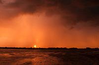 Sunset with lightning on Prypiat river, Belarus