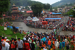 Aug. 21, 2017 - Kathmandu, Nepal - Hindu devotees gather to perform religious rituals to celebrate Kuse Aunsi, or Father's Day, on the bank of Bagmati River at Gokarna Temple in Kathmandu, Nepal. Kuse Aunsi is a Hindu festival in which fathers, living or past, are honored.   (Credit Image: © Sunil Sharma/Xinhua via ZUMA Wire)