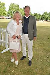 BROOK JOHNSON and his wife SALLY at the Flannels For Heroes cricket competition in association with Dockers held at Burton Court, Chelsea, London on 19th June 2015