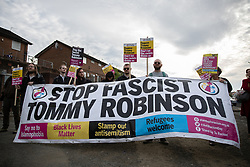 © Licensed to London News Pictures . 22/05/2019. Salford, UK. ANTI FASCISTS protest the rally with a banner . Former EDL leader Stephen Yaxley-Lennon (aka Tommy Robinson ) holds a campaign rally at the derelict Mocha Parade shopping precinct in Salford , opposed by anti-fascists . Yaxley-Lennon is running for a seat in the European Parliament representing the North West of England . Photo credit: Joel Goodman/LNP