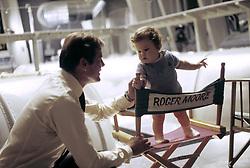 January 1, 1974 - Hollywood, California, U.S. - Roger Moore with son Christian Moore on the set ot ''The Man with the Golden Gun,'' 1974. *** NO ITALY *** NO AMI *** NO SKINS OR TABS  (Credit Image: © Armando Gallo via ZUMA Studio)