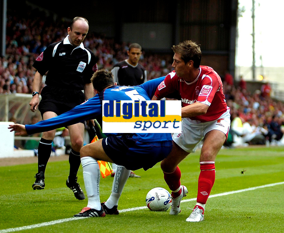 Photo: Ed Godden.<br />Nottingham Forest v Bradford City. Coca Cola League 1.<br />05/08/2006. Mark Bower (L) and Forest's Nicky Southall fight for the ball.