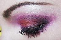 caucasian woman eye  makeup with pink eyeshadow