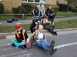 © Licensed to London News Pictures. 13/10/2021. London, UK. Locals drag members of the Insulate Britain climate change group as they block London Road in Thurrock near the Dartford Crossing. Harsher punishments are to be introduced by the government to deal with climate change activists, who continue to block motorways and major roads causing disruption. Photo credit: Peter Macdiarmid/LNP