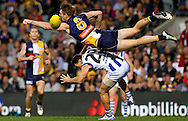 PERTH, AUSTRALIA - MAY 17: Beau Waters of the Eagles attempts to spoil the mark for Brent Harvey of the Kangaroos during the round eight AFL match between the West Coast Eagles and the North Melbourne Kangaroos at Patersons Stadium on May 17, 2013 in Perth, Australia.  (Photo by Paul Kane/Getty Images)