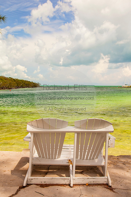 Two chairs looking out on the Abaco Sea in the tiny village of Hope Town, Elbow Cay Abacos, Bahamas.