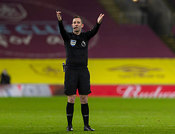 BURNLEY, ENGLAND - Tuesday, December 29, 2020: Referee Chris Kavanagh waves play on during the FA Premier League match between Burnley FC and Sheffield United FC at Turf Moor. Burnley won 1-0. (Pic by David Rawcliffe/Propaganda)