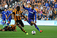 Cardiff city's Fraizer Campbell goes past Hull's Maynor Figueroa. . Barclays Premier league match, Hull city v Cardiff city at the KC Stadium in Hull on Sat 14th Sept 2013. pic by Andrew Orchard, Andrew Orchard sports photography,