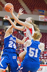 03 January 2014:  Alison Seberger leaps for the hoop which is protected by Ashley Bartow and Cara Lutes during an NCAA women's basketball game between the Drake Bulldogs and the Illinois Sate Redbirds at Redbird Arena in Normal IL