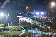 TAIPEI, CHINA - FEBRUARY 04: (CHINA OUT, TAIWAN OUT) <br /> <br /> TransAsia Airways Plane Crash<br /> <br /> Rescue teams work to free people from a TransAsia Airways ATR 72-600 turboprop airplane that crashed into the Keelung River with the help of large crane on February 4, 2015 in Taipei, Taiwan of China. The TransAsia Airways ATR 72-600 turboprop airplane crashed into the Keelung River shortly after taking off from Taipei Songshan airport on Wednesday. Over 50 people were onboard the aircraft when it clipped a bridge and crashed into the river. At least thirty one deaths have currently been reported and the injured have been sent to the nearest hospitals. The airplane was crashed when it took off in four minutes and the weather was suitable for flying that further possible causes were under investagation. <br /> ©Exclusivepix Media
