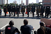 Protesters sit in front of Police line. Police clash with several hundred protesters in Sao Paulo, Brazil, using tear gas and stun grenades on the opening day of the FIFA World Cup 2014. There were some arrests and injuries inlcuding a CNN producer. The protesters were dispearsed relatively quickly due to the Brazilian Police's early show of force.