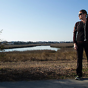 """Lisa Carter Hoffacker poses for a portrait at """"The Loop"""" in Wrightsville Beach, N.C. Hoffacker, an avid runner is running the Quintiles Wrightsville Beach Half Marathon for the first time this year. Hoffacker has missed the Quintiles each year due to injury and even emergency gall bladder surgery. (Jason A. Frizzelle)"""