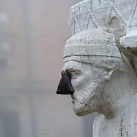 VENICE, ITALY - JANUARY 05: The face of the statue of Rioba is seen as thick fog shrouds Campo de Mori and the all the city, on January 5, 2012 in Venice, Italy. Venice woke up this morning under a heavy blanket of fog adding to the atmosphere of the city.