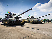 29 SEPTEMBER 2014 - NAKHON NAYOK, NAKHON NAYOK, THAILAND: Royal Thai Army T-84 main battle tanks parade past the reviewing stand at the retirement ceremony for more than 200 Thai generals including Gen. Prayuth Chan-ocha, who led the 22 May coup against the civilian government earlier this year. Prayuth has been chief of the Thai army since 2010. After his retirement, Gen. Prayuth will retain his posts as head of the junta's National Council for Peace and Order (NCPO) and Prime Minister of Thailand. Under Thai law, military officers must retire at 60 years of age. The 200 generals who retired with Prayuth were also his classmates at the Chulalomklao Royal Military Academy in Nakhon Nayok. The T84 is Thailand's main battle tank. The tanks were purchased from Ukraine.    PHOTO BY JACK KURTZ