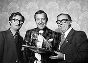 Entertainer Val Doonican is presented with the VATS Award. On the trophy are a miniature guitar and the singer's trademark rocking chair. The Waterford born singer has had a very successful career in Britain, including his own BBC TV show, 'The Val Doonican Show', that broadcast for 20 years.<br /> 10/10/1977
