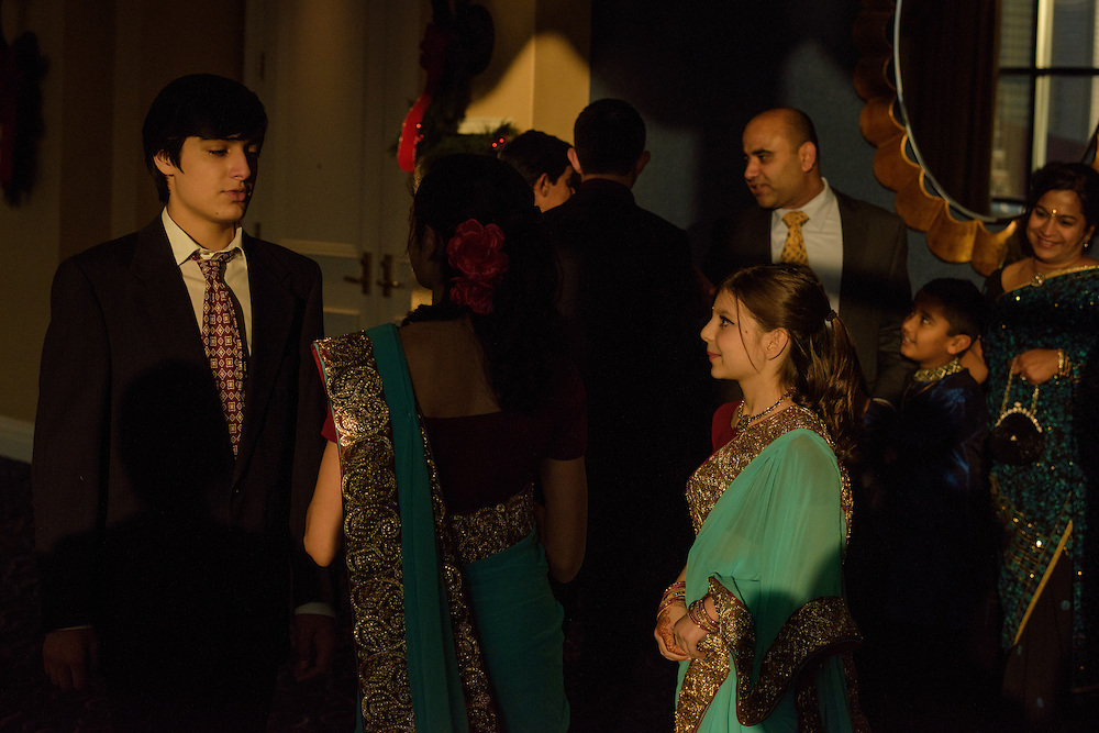 Baltimore, Maryland - December 20, 2014: Attendees of Trisha Satya Pasricha and Eshwan Ramudu wedding socialize before the ceremony at the Baltimore Marriott Waterfront Hotel December 20, 2014. <br /> <br /> <br /> CREDIT: Matt Roth for The New York Times<br /> Assignment ID: 30168620A