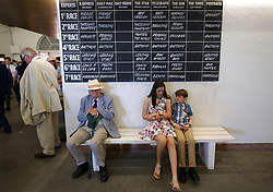 Racegoers during day four of the Qatar Goodwood Festival at Goodwood Racecourse, Chichester.