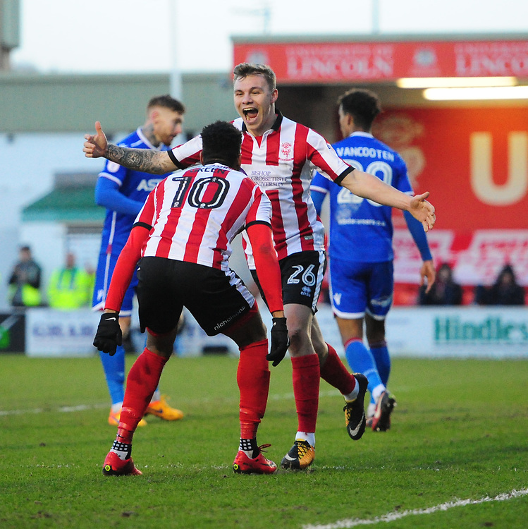 Lincoln City's Harry Anderson celebrates scoring the opening goal with team-mate Matt Green<br /> <br /> Photographer Chris Vaughan/CameraSport<br /> <br /> The EFL Sky Bet League Two - Lincoln City v Stevenage - Tuesday 26th December 2017 - Sincil Bank - Lincoln<br /> <br /> World Copyright © 2017 CameraSport. All rights reserved. 43 Linden Ave. Countesthorpe. Leicester. England. LE8 5PG - Tel: +44 (0) 116 277 4147 - admin@camerasport.com - www.camerasport.com