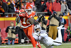 Dec 8, 2016; Kansas City, MO, USA; Kansas City Chiefs wide receiver Tyreek Hill (10) runs in for a touchdown as Oakland Raiders cornerback David Amerson (29) attempts the tackle during the first half at Arrowhead Stadium. Mandatory Credit: Denny Medley-USA TODAY Sports