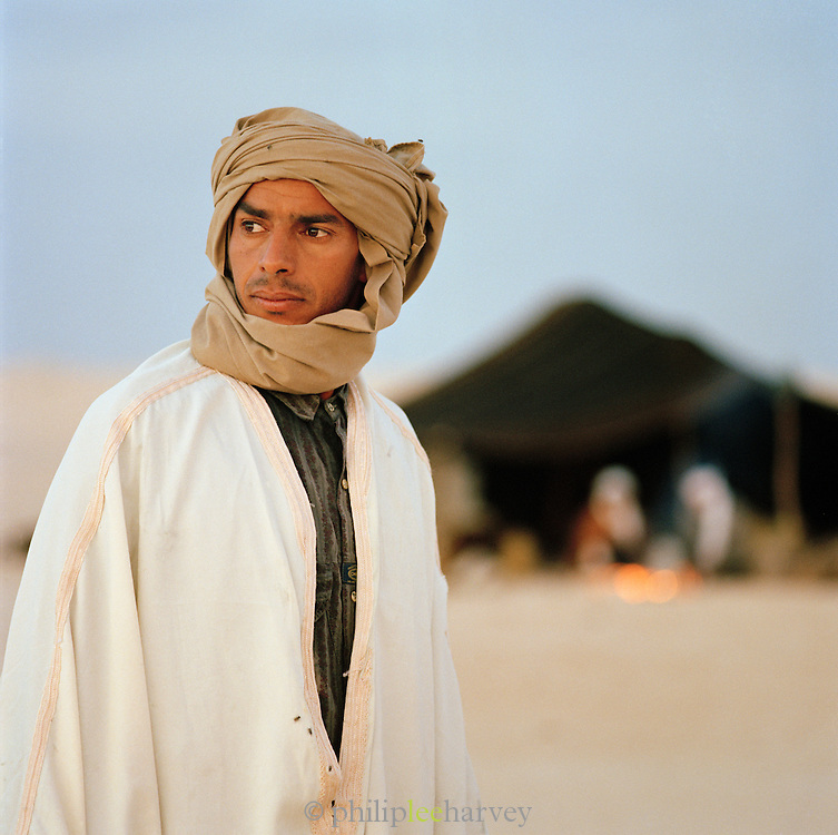 A camel trader at camp in the Saharah desert in the south of Tunisia