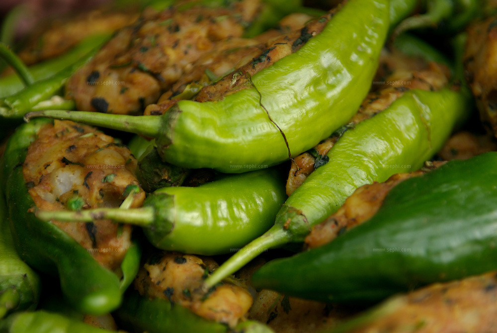 Green chilli peppers, stuffd with potato and spices ready to be dipped in batter and deep fried to make Rajasthan's special Mirchi Pakora