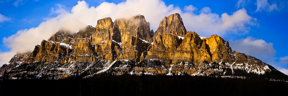 A panoramic shot of Castle Mountain as seen from the Bow Valley Parkway.  Castle is located halfway between Banff and Lake Louise on the Bow Valley Parkway, and is a popular mountain for hiking and climbing...©2009, Sean Phillips.http://www.Sean-Phillips.com