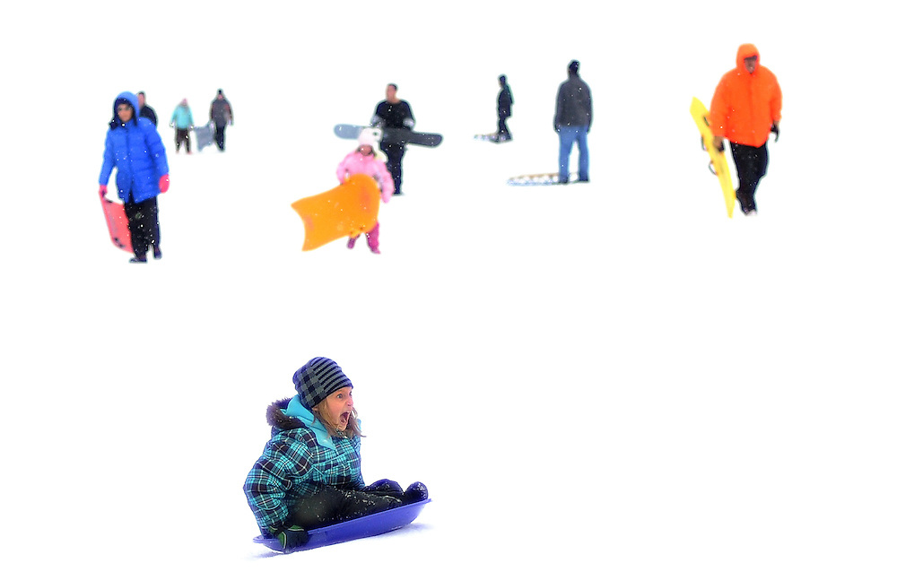 Nine-year old Julia Lash (foreground) of Brick, along with children of all ages, enjoy rides down sledding hill located next to the Howell Township Library in Howell, New Jersey on February 26, 2010.  Children of all ages took advantage of the fresh snow left over from winter season's fourth major snowstorm.