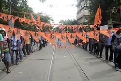August 16, 2017 - Kolkata, West Bengal, India - Hindu activist rallied with their saffron flag for their demand in Kolkata. Activist of Hindu Samhati holds a rally for the demands of Hindus and also pay tribute to Gopal Chandra Mukhapadhya or Gopal Pantha who protect Hindu during Great Calcutta Killing in 1946 on August 16, 2017 in Kolkata. (Credit Image: © Saikat Paul/Pacific Press via ZUMA Wire)