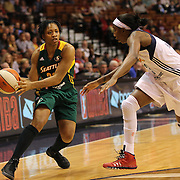 Tanisha Wright, (left), Seattle Storm, prepares to pass while challenged by Allison Hightower, Connecticut Sun, during the Connecticut Sun Vs Seattle Storm WNBA regular season game at Mohegan Sun Arena, Uncasville, Connecticut, USA. 23rd May 2014. Photo Tim Clayton