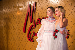 (left to right) Saoirse Ronan and Margot Robbie arrive at the European premiere of Mary Queen of Scots at Cineworld Leicester Square, London.