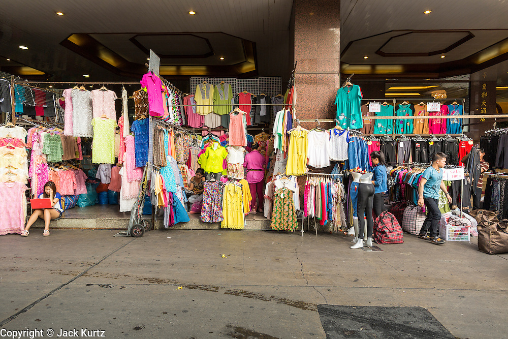06 JUNE 2013 - BANGKOK, THAILAND:     Clothing stalls in Bobae Market in Bangkok. Bobae Market is a 30 year old market famous for fashion wholesale and is now very popular with exporters from around the world. Bobae Tower is next to the market and  advertises itself as having 1,300 stalls under one roof and claims to be the largest garment wholesale center in Thailand.       PHOTO BY JACK KURTZ