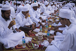 June 4, 2017 - Kuala Lumpur, Malaysia - Muslims break their fast during the holy month of Ramadan at Dataran Merdeka (Independent Square) on June 4, 2017 in Kuala Lumpur, Malaysia. Muslims around the world are observing the fasting month of Ramadan, Muslims refrain from eating , drinking from dawn until sunset  (Credit Image: © Mustaqim Khairuddin/NurPhoto via ZUMA Press)